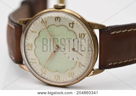 wintage gold yellow auto watch with white background