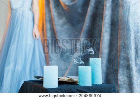 Beautiful shapely bride in a blue wedding dress. The evening ceremony by candlelight in the interior. A wedding in the style of boho loft.