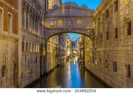 Bridge of Sighs Ponte dei Sospiri illumitaed at blue hour sunset night in Venice, Italy. Famous landmark