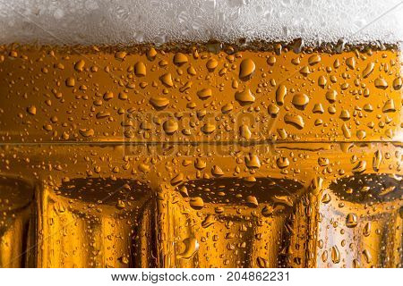 Close up of a cold light beer in a mug