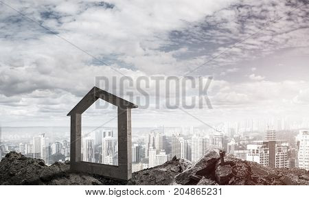 House stone figure as symbol of construction and real estate outdoors