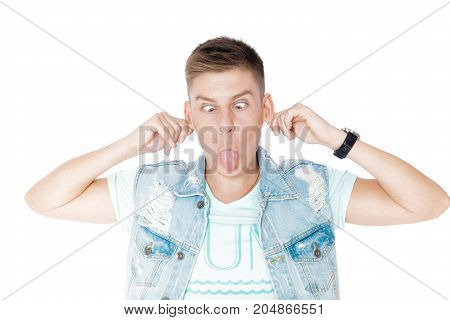handsome funny young man in denim isolated white background