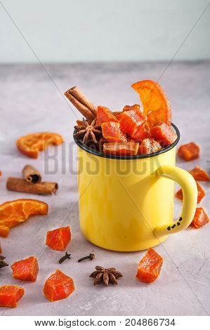 candied pumpkinin cup for halloween with spicies and oranges