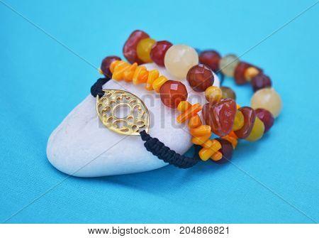 orange coral gemstone bracelets - gold byzantine jewelry - fashion accessories advertisement