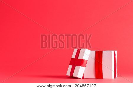 Small present box on a red background