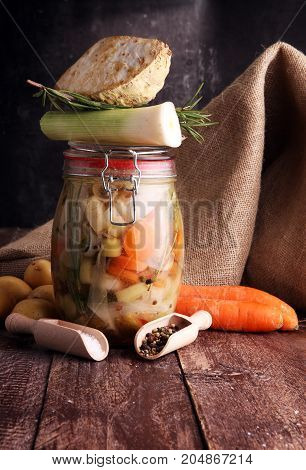 Jar With Variety Of Pickled Vegetables. Broth, Carrots, Field Ga