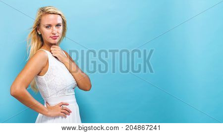Beautiful young woman on a solid background