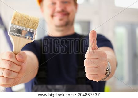 Arms Of Worker Hold Paint Brush And Show Confirm Sign