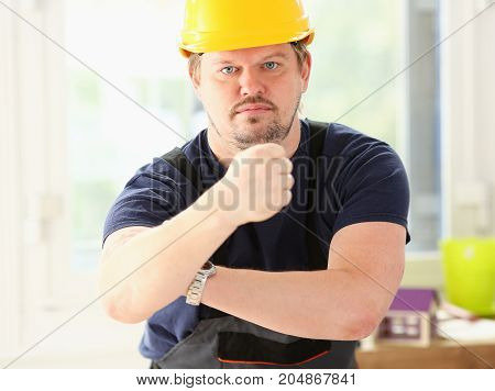 Smiling Funny Worker In Yellow Helmet Posing