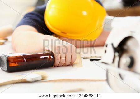 Arm Of Drunken Worker In Yellow Helmet