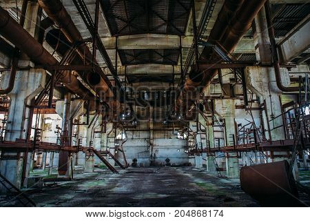 Abandoned metallurgical factory or warehouse left by people after war, toned