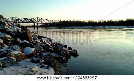Snow covered rocks along the Missouri River in Saint Charles Missouri
