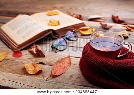 Cup Of Hot Tea On Wooden Table.open Book Andred Autumn Leaves.autumn Mood Concept.