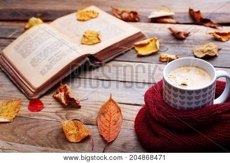 Cup Hot Cappuccino Coffee On Wooden Table With Autumn Leaves ,book.autumn Concept.warm Autumn Pictur