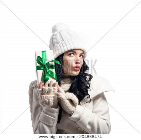 Young woman holding a Christmas gift box