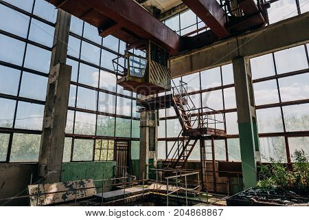 Ruins of abandoned polluted industrial factory room, abandoned industrial building after war, toned