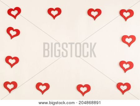 Red small hearts on a white background