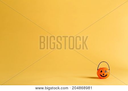 Halloween pumpkin decoration on a yellow-orange background