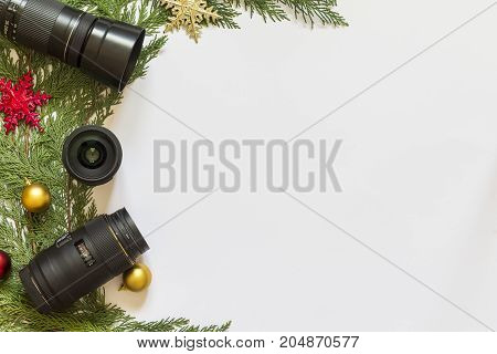 Lenses for reflex camera and Christmas decorations on a white background