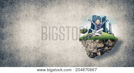 ECO concept floating island and happy kid girl with book sitting on it