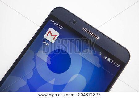 Minsk Belarus - September 17 2017: Gmail app icon on modern smartphone display close-up on white background