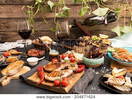 Overhead Of Dinner Table. Assorted Delicious Grilled Barbecue Meat And Seafood With Vegetable. Pork
