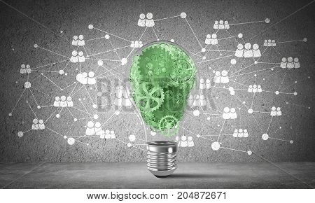 Lightbulb with multiple gears inside placed against social network system on grey wall. 3D rendering.
