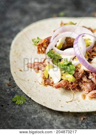 close up of rustic mexican american pulled pork tacos