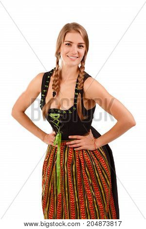 German or Bavarian waitress with her hair in pigtails wearing a traditional dirndl. Oktoberfest concept .