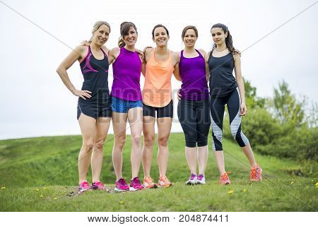 A Happy running team on the grass having fun
