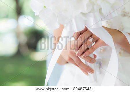Bride hand with bride rings - Selective focus.