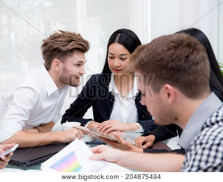 Group of business people brainstorming together in the meeting room.