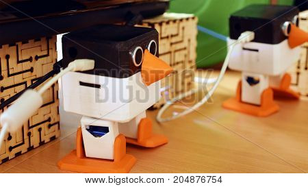 Toy automatic robots are dancing on the table. Robotics and artificial intelligence come to human's life quickly.