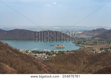 From the top horizontal picture of Jal Mahal located in the middle of the Man Sagar Lake in Jaipur city the capital of the state of Rajasthan India.