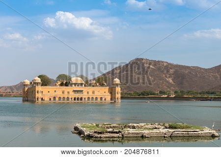Front picture of Jal Mahal located in the middle of the Man Sagar Lake in Jaipur city the capital of the state of Rajasthan India.