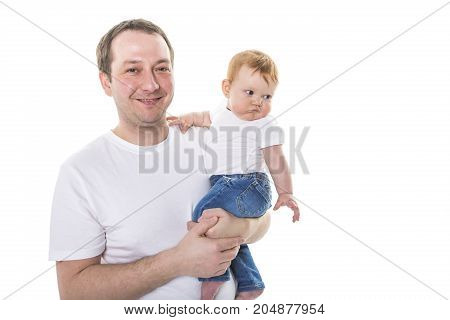 A Young Caucasian father holding and kissing adorable baby, isolated on white