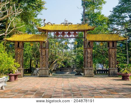 Hue, Vietnam - September 13 2017: Old enter of an arch with a yellow roof, in Hue Vietnam.