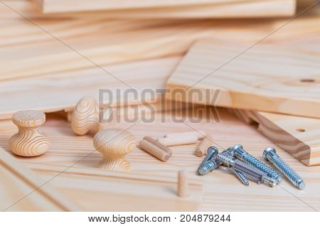 Close up of assembly furniture kit over Wood planks background