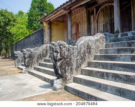 Dragon decor on pavilion in garden of Citadel in Hue. Vietnam.