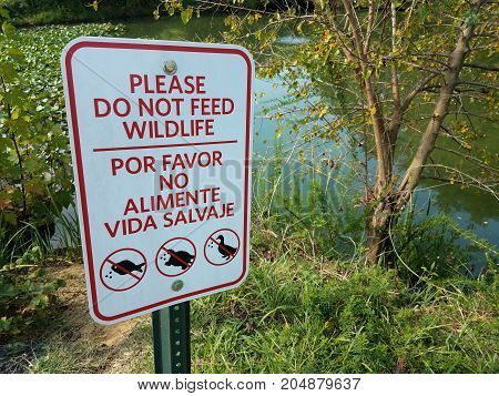 please do not feed wildlife sign and water and plants