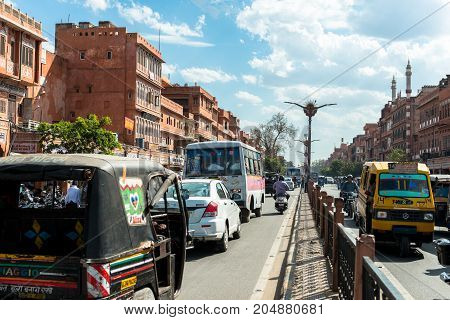 JAIPUR RAJASTHAN INDIA - MARCH 11 2016: Horizontal picture car traffic in the street of Jaipur known as pink city of Rajasthan in India.