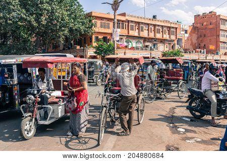 JAIPUR RAJASTHAN INDIA - MARCH 11 2016: Horizontal picture of tuk tuk motorcycle and rickshaw in Jaipur known as pink city of Rajasthan in India.