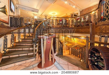 MOSCOW - AUGUST 2014: The restaurant's interior is home to the Armenian and Caucasian cuisine. Stand for the reception of visitors on the Grand staircase between the lower and upper hall