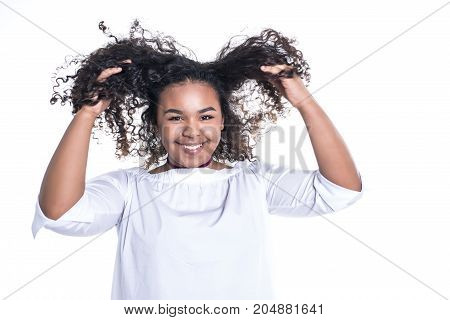 A Beautiful young african woman posing isolated over white