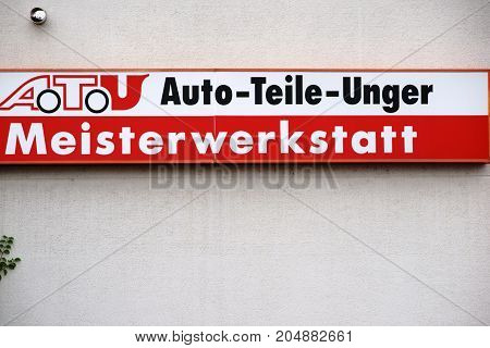 MAINZ, GERMANY - 16 JULY: The company sign of the garage and tire changer ATU Auto Parts Unger on the facade of a building on July 16 2017 in Mainz.