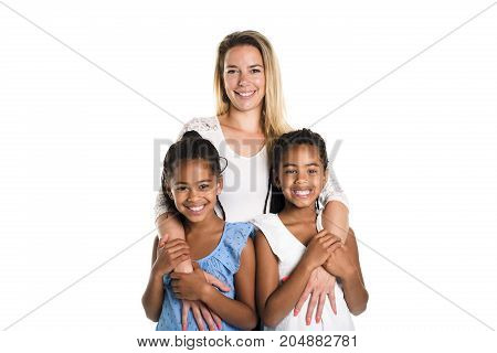 Two Afro twin child posing on a white background studio with white mother