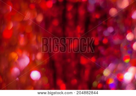 Abstract blurred dark red background with bokeh lights