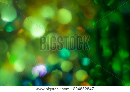 Abstract blurred dark green background with bokeh lights