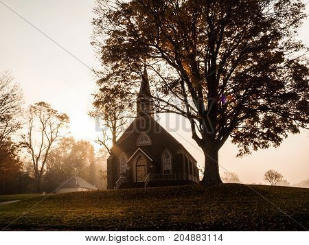 A sepia toned silhouette of a church on a hillside in central New Jersey.