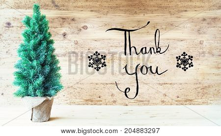 Calligraphy With English Text Thank You. Green Christmas Tree With Rustik Brown Wooden Background.